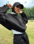Nike ruched sleeve swoosh zip jacket in black
